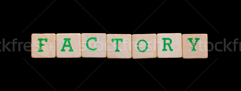Letters on old wooden blocks (factory) Stock photo © michaklootwijk