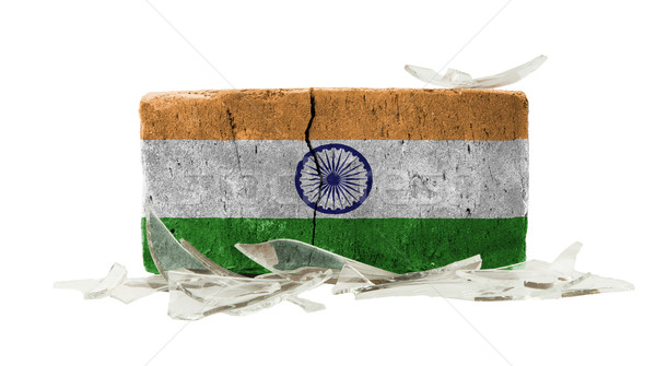 Stockfoto: Baksteen · gebroken · glas · geweld · vlag · Indië · muur