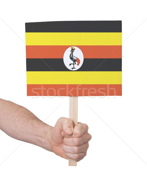 Hand holding small card - Flag of Uganda Stock photo © michaklootwijk