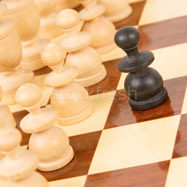 Black pawn on a wooden chessboard Stock photo © michaklootwijk