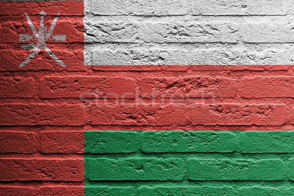 Tuğla duvar boyama bayrak Umman yalıtılmış Bina Stok fotoğraf © michaklootwijk