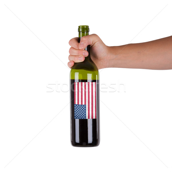 Hand holding a bottle of red wine Stock photo © michaklootwijk