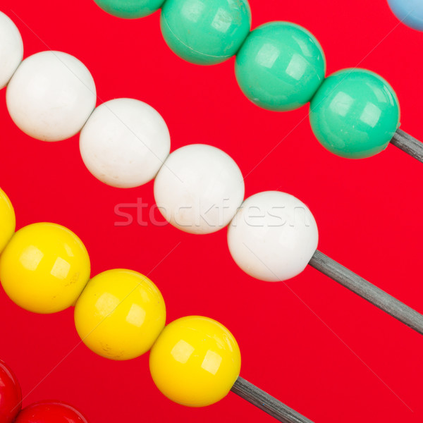 Close-up of an abacus on a red background Stock photo © michaklootwijk