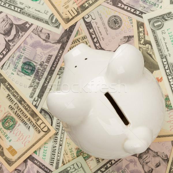 Piggy bank on dollar bills, focus on the pig Stock photo © michaklootwijk