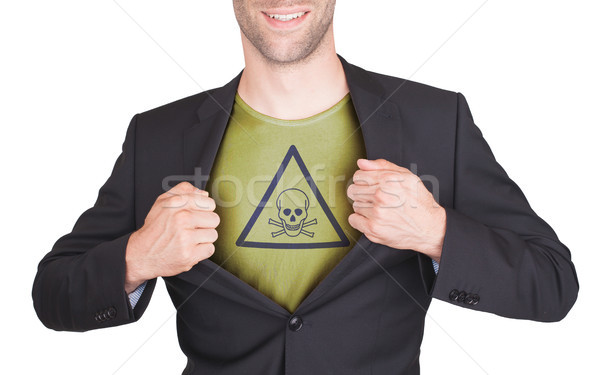 Businessman opening suit to reveal shirt with sign Stock photo © michaklootwijk