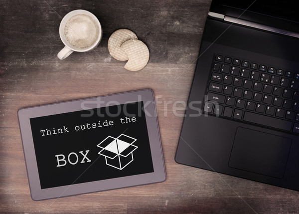 Tablet touch computer gadget on wooden table, think outside the  Stock photo © michaklootwijk