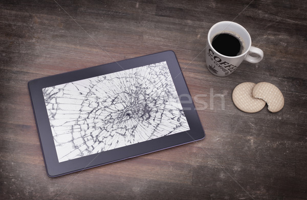Tablet computer with broken glass Stock photo © michaklootwijk