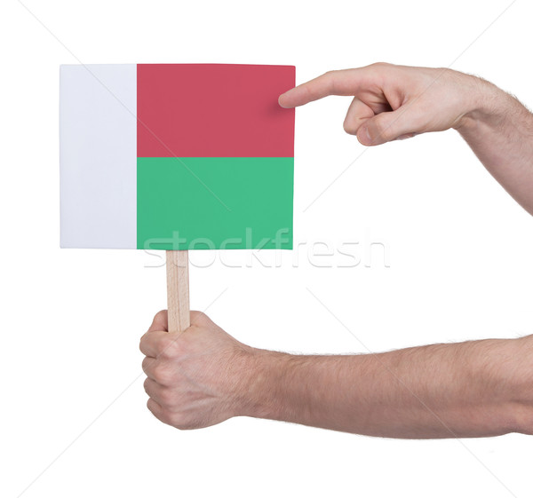 Hand holding small card - Flag of Madagascar Stock photo © michaklootwijk
