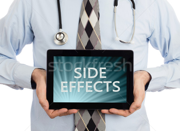 Doctor holding tablet - Side effects Stock photo © michaklootwijk