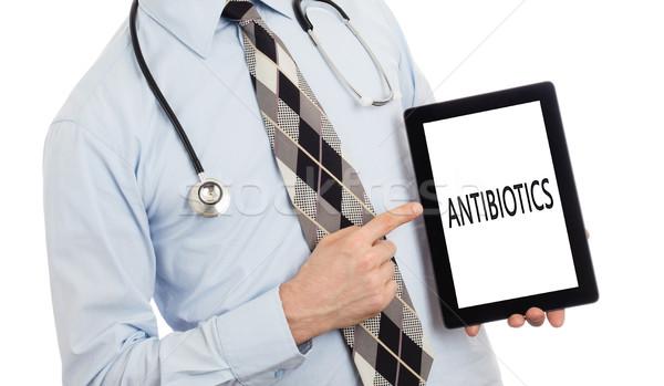 Orvos tart tabletta antibiotikum izolált fehér Stock fotó © michaklootwijk
