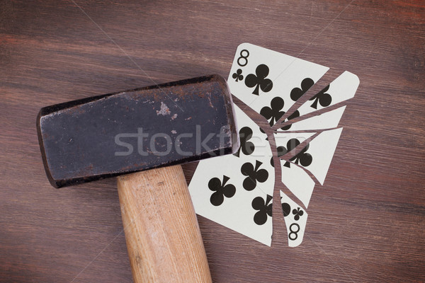 Hammer with a broken card, eight of clubs Stock photo © michaklootwijk