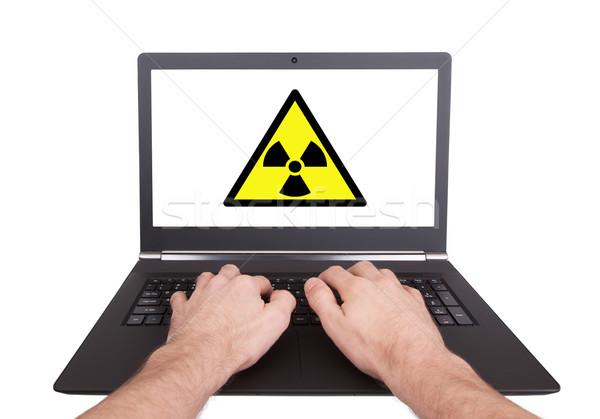 Człowiek pracy laptop promieniowanie odizolowany strony Zdjęcia stock © michaklootwijk
