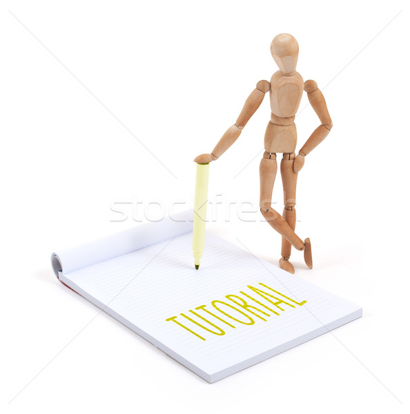 Wooden mannequin writing - Tutorial Stock photo © michaklootwijk