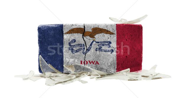 Mattone vetri rotti violenza bandiera Iowa muro Foto d'archivio © michaklootwijk