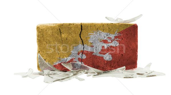 Foto stock: Ladrillo · vidrios · rotos · violencia · bandera · Bután · pared