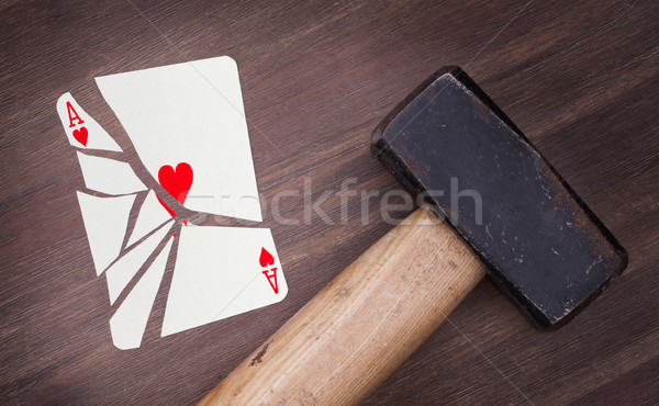 Hammer with a broken card, ace of hearts Stock photo © michaklootwijk