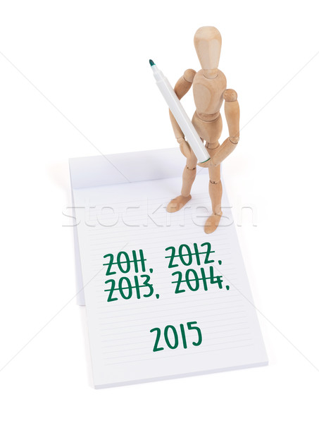 Wooden mannequin writing - 2015 Stock photo © michaklootwijk