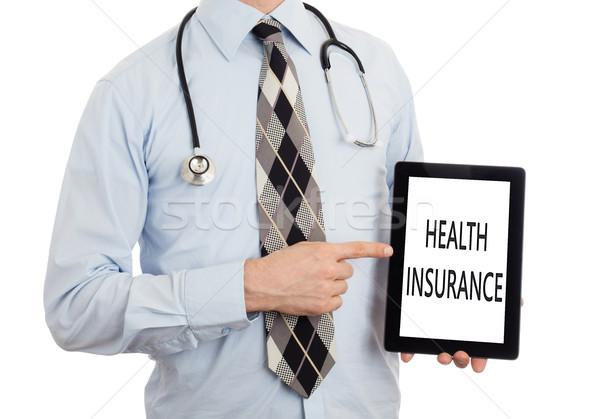 Orvos tart tabletta egészségbiztosítás izolált fehér Stock fotó © michaklootwijk