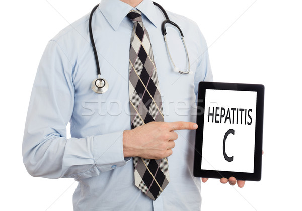 Doctor holding tablet - Hepatitis C Stock photo © michaklootwijk