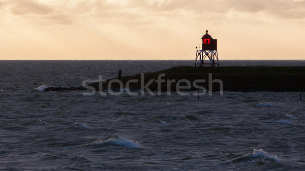 Silhouette of a red beacon at the dutch coast Stock photo © michaklootwijk