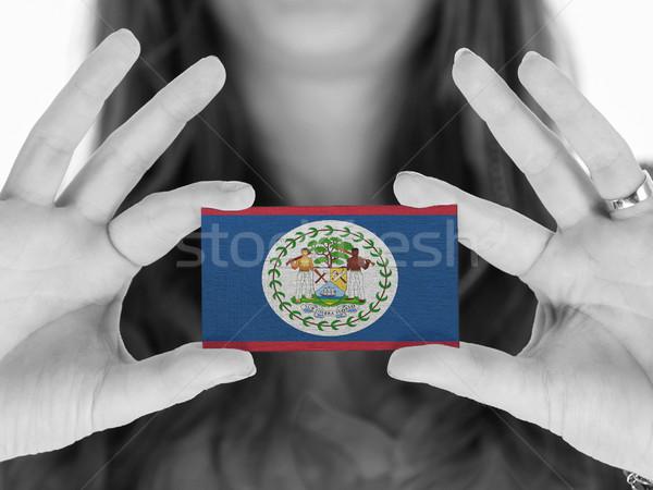 Vrouw tonen visitekaartje vlag Belize ruimte Stockfoto © michaklootwijk
