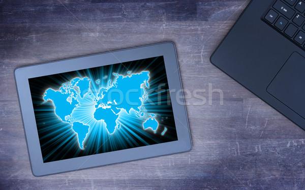 Мир карта таблетка холодно синий бизнеса Сток-фото © michaklootwijk