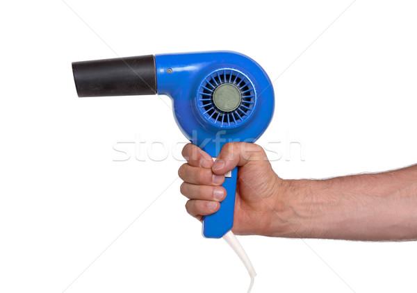 Old blue hairdryer in hand Stock photo © michaklootwijk