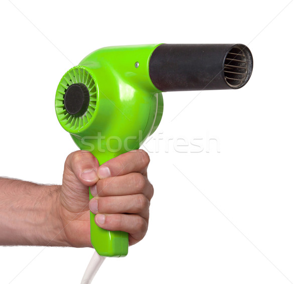 Stock photo: Old green hairdryer in hand