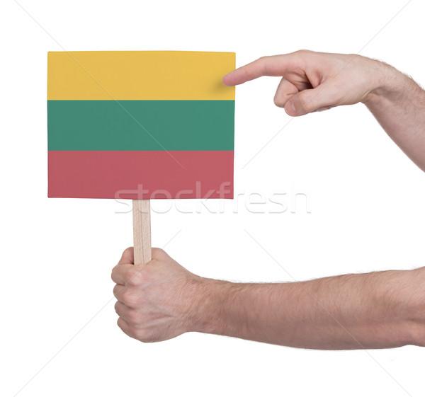 Kéz tart kicsi kártya zászló Litvánia Stock fotó © michaklootwijk
