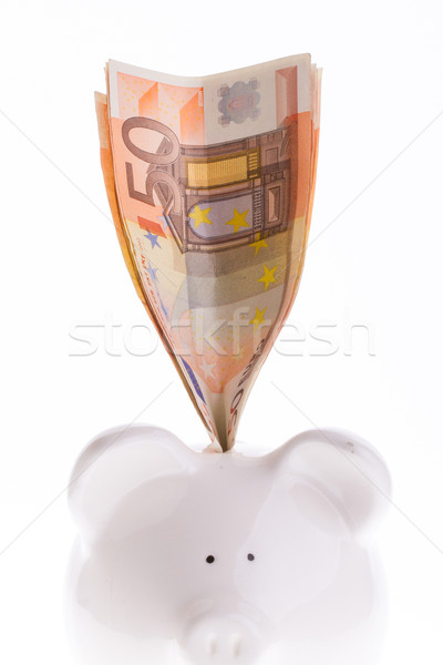 Saving fifty euro in a white money box Stock photo © michaklootwijk