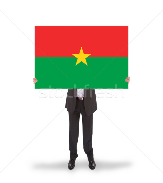 Businessman holding a big card, flag of Burkina Faso Stock photo © michaklootwijk