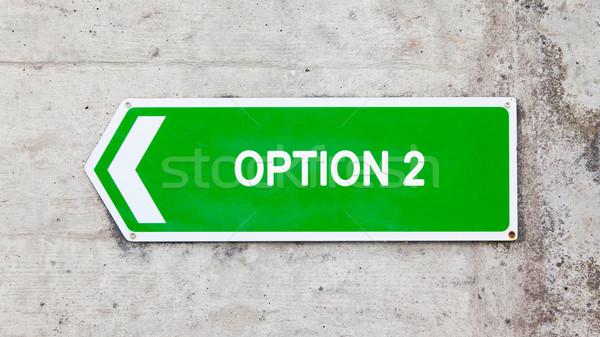 Verde segno opzione concrete muro arrow Foto d'archivio © michaklootwijk