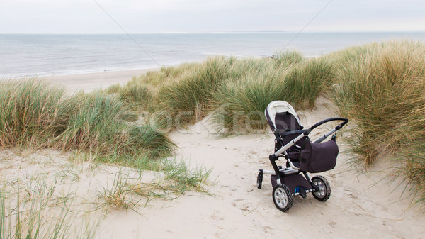 Baby stroller standing at a beach  Stock photo © michaklootwijk
