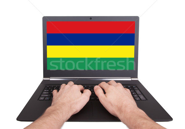 Hands working on laptop, Mauritius Stock photo © michaklootwijk