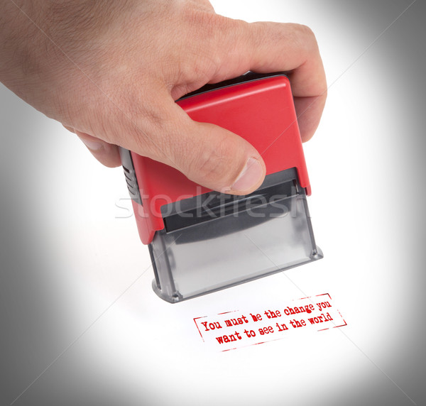 Plastic stamp in hand, isolated Stock photo © michaklootwijk