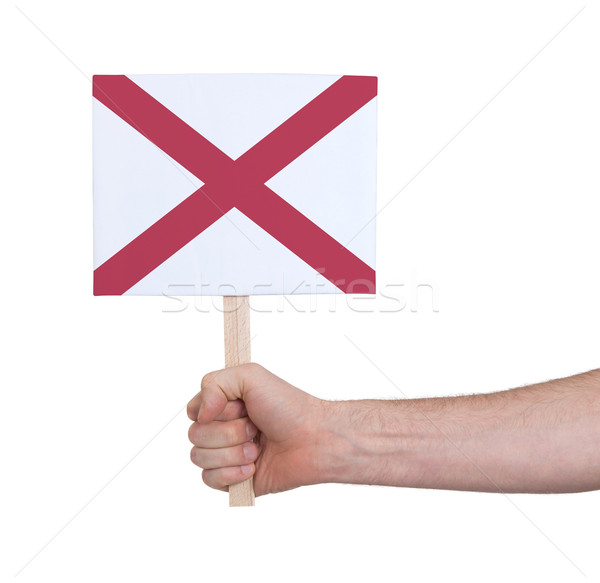 Hand holding small card - Flag of Alabama Stock photo © michaklootwijk