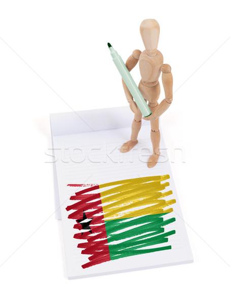 Fából készült próbababa rajz Guinea zászló papír Stock fotó © michaklootwijk