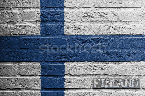 Brick wall with a painting of a flag, Finland Stock photo © michaklootwijk