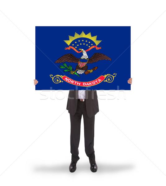 Glimlachend zakenman groot kaart vlag Stockfoto © michaklootwijk