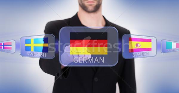 ストックフォト: 手 · プッシング · タッチスクリーン · インターフェース · 言語