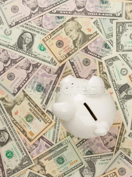 Piggy bank on dollar bills Stock photo © michaklootwijk