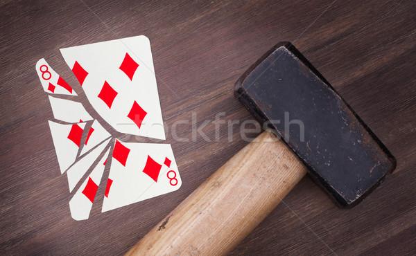 Hammer with a broken card, eight of diamonds Stock photo © michaklootwijk