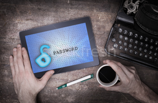 Tablet on a desk, concept of data protection Stock photo © michaklootwijk
