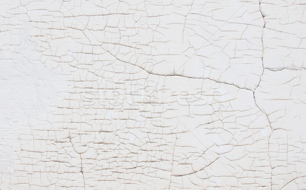 Blanco pared grietas edad textura edificio Foto stock © michaklootwijk