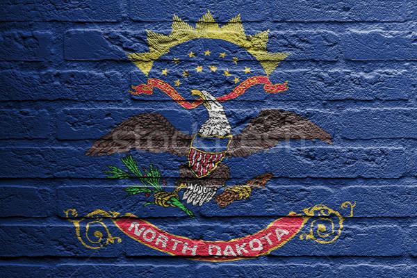 Muur schilderij vlag North Dakota geïsoleerd verf Stockfoto © michaklootwijk