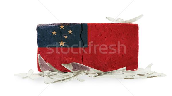 Stockfoto: Baksteen · gebroken · glas · geweld · vlag · Samoa · muur