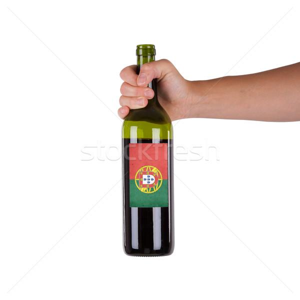 Mano botella vino tinto etiqueta Portugal Foto stock © michaklootwijk
