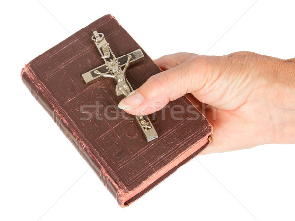 Old hand (woman) holding a very old bible Stock photo © michaklootwijk