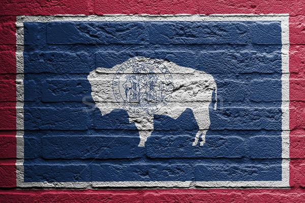 Pared de ladrillo pintura bandera Wyoming aislado ladrillo Foto stock © michaklootwijk