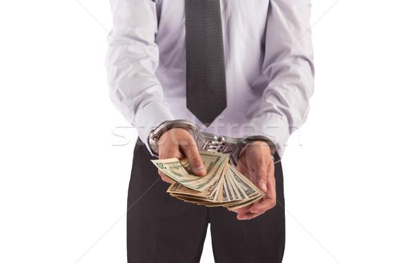 Uomo d'affari manette arrestato isolato bianco soldi Foto d'archivio © michaklootwijk